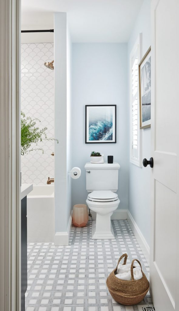 Designed by Vanessa Francis, this charming bathroom features Masonite's Logan interior door.