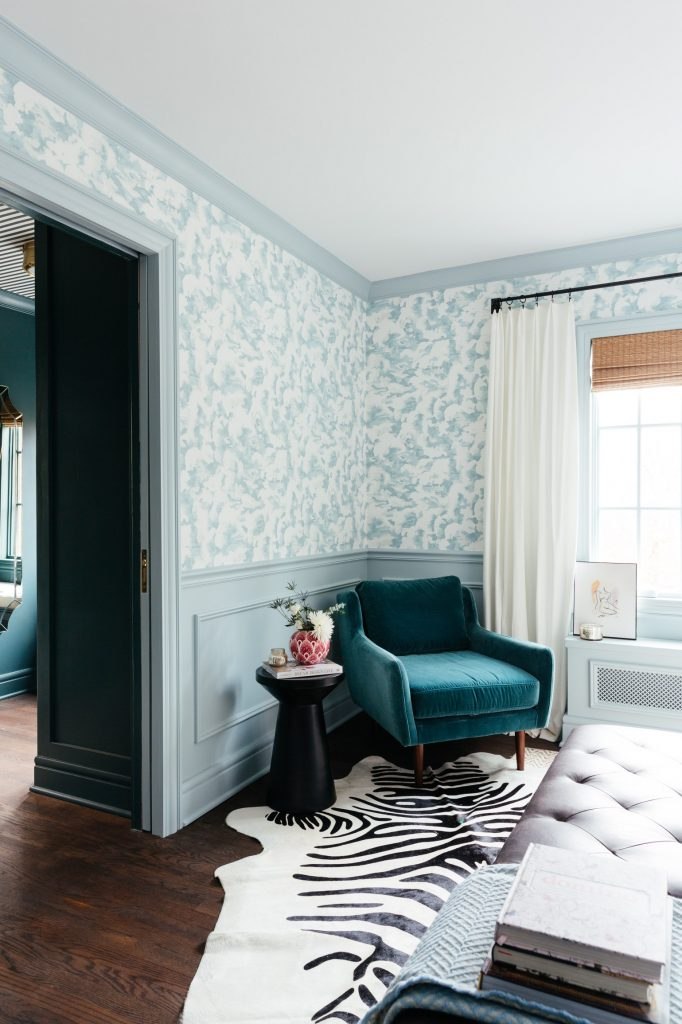 Erin's master bedroom uses pastel blue wall treatments to evoke the feeling of a fresh summer day!
