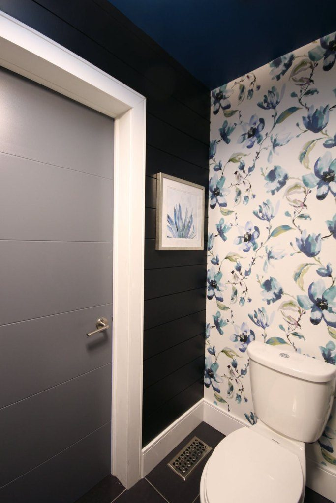 A sleek powder room with Metrie's shiplap
