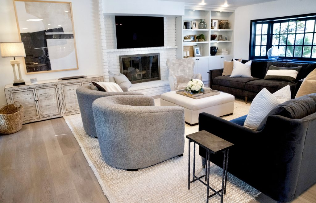 A beautiful living room design by Nate and Jeremiah, featuring Metrie's interior finishings