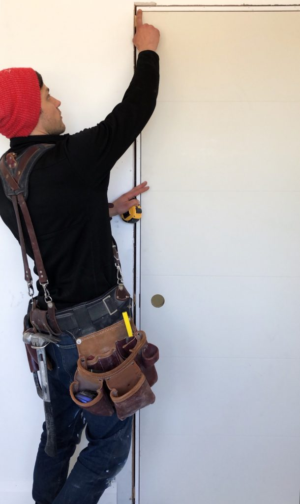 Learn how to install a slab door with Metrie and Ecnomus Construction