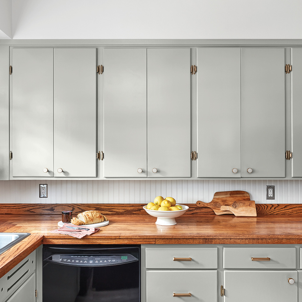 Kitchen with Gray-Green Linen Cabinets and White Vertical Shiplap Backsplash
