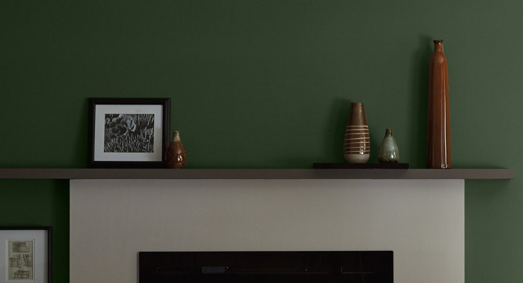 Deep Green Wall with White Fireplace