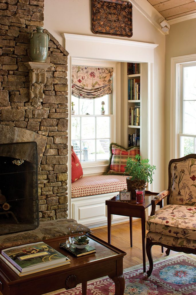 Country Cottage Living Room with a Stone Fireplace and Built-in Reading Nook