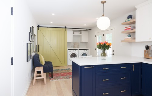 Kitchen with Blue Cabinets and a Green Sliding Wood Door